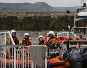 Lyme Regis Lifeboat crew return after the rescue